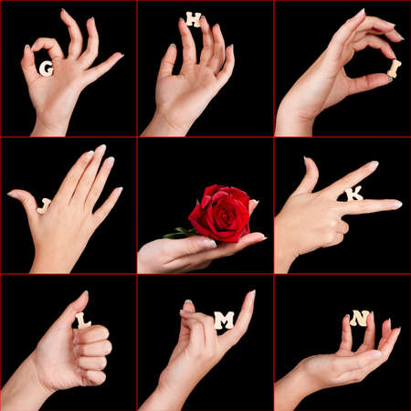 Elegant female hands showing part of the alphabet in wooden letters photo