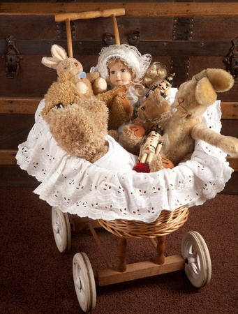 cradle: Antique toys and doll lying in a wooden vintage cradle Stock Photo