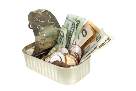 sardine can: Sardine can filled with dollars both coins and paper money Stock Photo