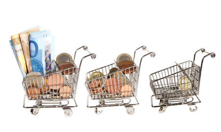 spending full: Three shopping carts full of money and one almost empty