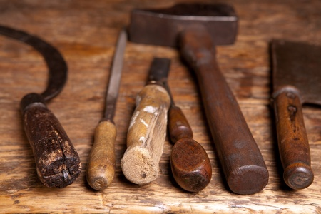 Antique rusty tools on an old wooden desk photo