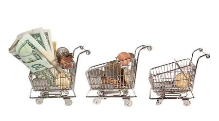 Three little shopping trolley full and empty after spending all the money photo