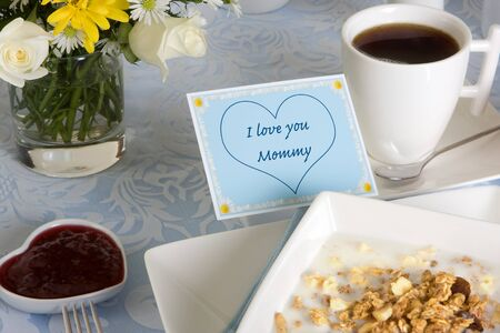 porcelain flower: Mothers day breakfast with coffee, flowers and cereals Stock Photo