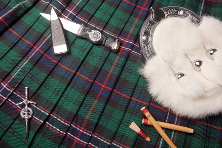 scot: Symbols of Scotland : kilt, pin, sporran, and bagpipe reeds
