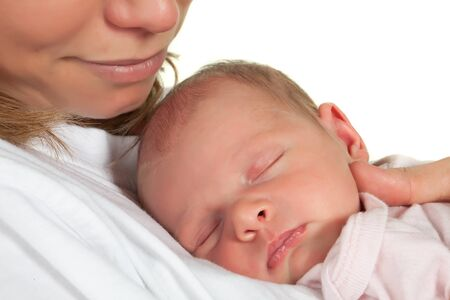 tender: Young mother watching her sleeping 18 days old baby