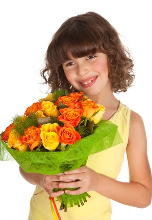 Little girl holding a bouquet of roses for mothers day photo