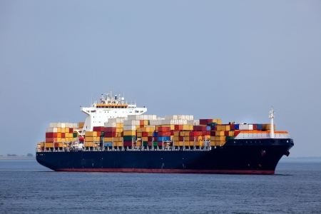 barge: Huge container ship passing - all brand names removed from every container