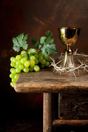 holy jug: Antique wine jug with grapes and a crown of thorns
