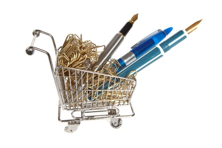 Little shopping cart filled with office supplies photo