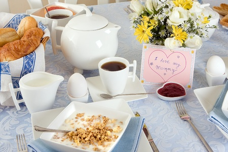 Mother's day breakfast with croissants, eggs and coffee Stock Photo - 9279181