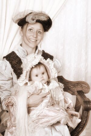 Vintage Victorian portrait of a happy mother with 4 months old baby photo