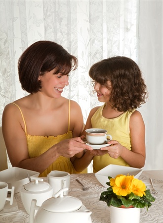 Little girl serving coffee on mother's day photo