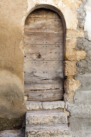 Medieval wooden door in Tourtour village in Provence, France photo