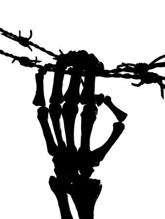 Skeleton hand trying to escape over barbed wire Stock Photo - 9449383