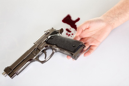 woman's hand: Womans hand lying on the floor after suicide with a gun Stock Photo