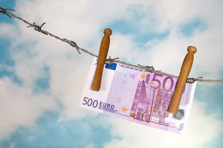 fifty euro banknote: Fifty euro banknote hanging on barbed wire Stock Photo