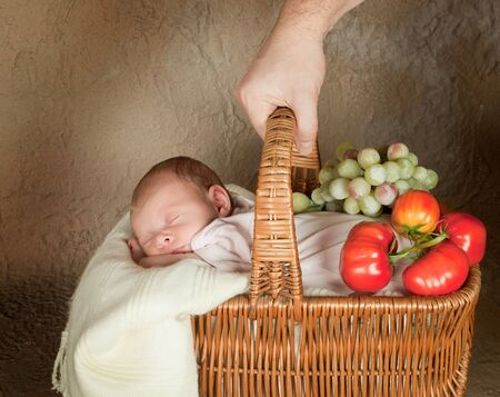 Vintage basket with groceries and an 18 year old sleeping baby photo