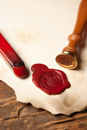Closeup of an ancient parchment or diploma scroll with wax seal photo