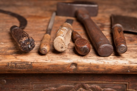 repair tools: Wooden bench with rusty grungy tools and handles Stock Photo