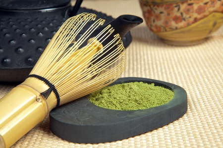 green drink powder: Closeup of green powder tea with teapot and bamboo whisk for zen ceremony