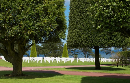 Graves overlooking the Atlantic Ocean at the American war cemetery in Normandy, France Stock Photo - 9684089