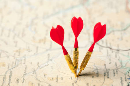 Three red darts in a shallow focus road map photo