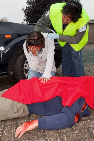 Injured woman and dead body after a car accident Stock Photo - 9944957