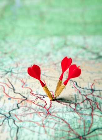 Green map with three red darts - shallow focus photo