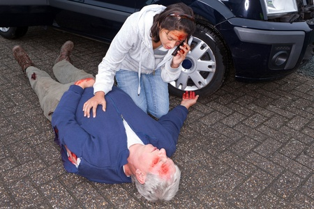 Wounded woman calling for an ambulance after a car accident photo