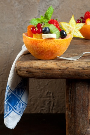 Fruit dessert on an antique table with vintage napkin photo