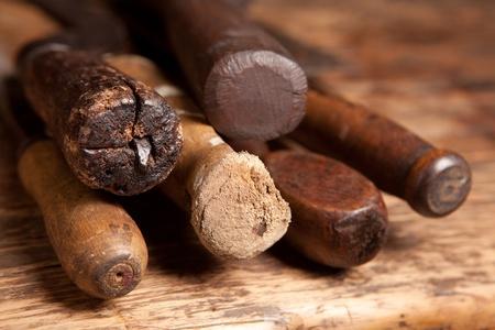 diy home repair: Wooden handles of very old rusty carpenter tools