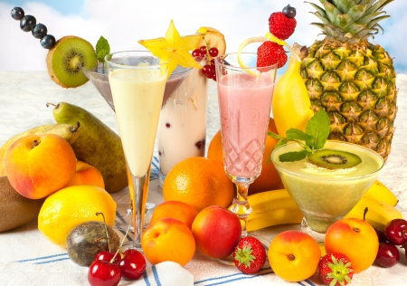 fruit smoothie: Diet table filled with summer fruits and colorful smoothies