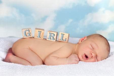 names: Four toy blocks with GIRL on a sleeping baby