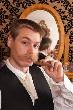 Victorian customer in a barber shop smoking a cigar Stock Photo - 10283750