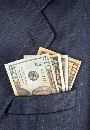 Dollar banknotes in a man's breast pocket