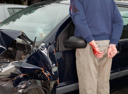 hand cuffs: Drunken driver being arrested after car crash