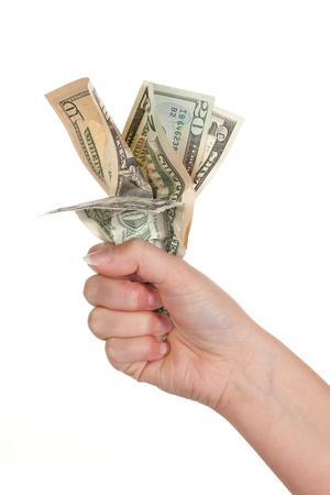 Female hand holding a bunch of dollar banknotes photo
