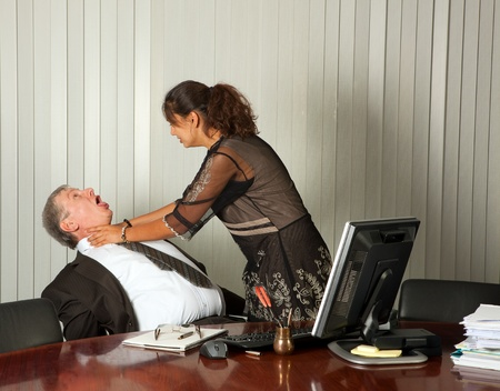 Frustrated assistant committing murder by strangling her boss Stock Photo - 10480466