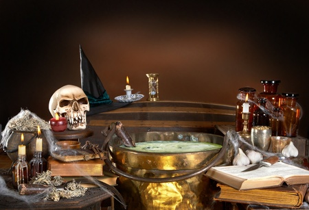 wicca: Halloween kitchen of a witch, with a cauldron full of poison soup, with copy space Stock Photo