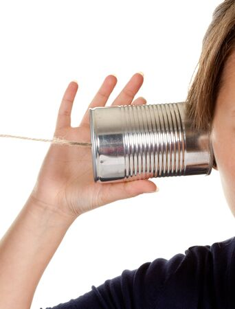 listening to people: Female hand making a phone call through a can and wire Stock Photo