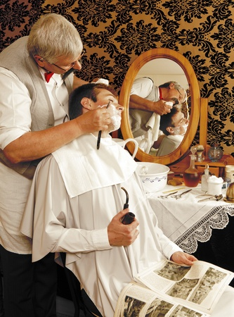shaving cream: Victorian barber shaving a customer (the antique magazine is from 1910).