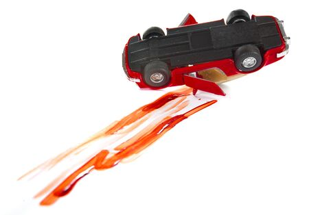 total loss: Blood marks and crashed toy car on a white background