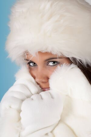 Winter girl with white fur hat wearing warm fur hat Stock Photo - 10673522