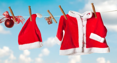 clothes peg: Santa hat and jacket hanging on a clothes line