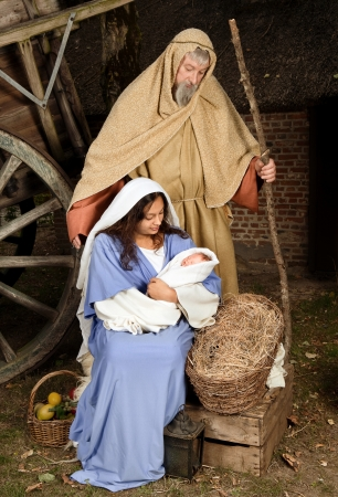 baby crib: Live Christmas nativity scene reenacted in a medieval barn Stock Photo