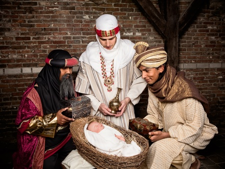 wisemen: Live Christmas nativity scene reenacted in a medieval barn Stock Photo