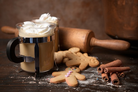 Gingerbread men cookie biscuits with hot coffee and whipped cream Stock Photo - 10761403