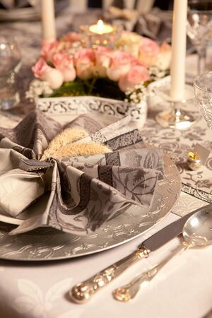 Artistically folded napkins on a fancy christmas table photo