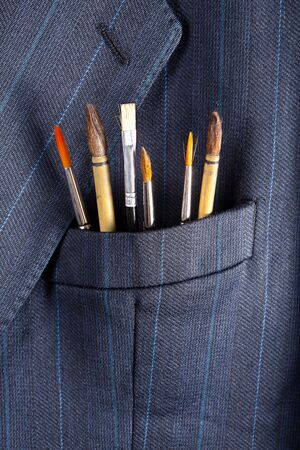 breast pocket: Paintbrushes in a breast pocket of a formal business suit