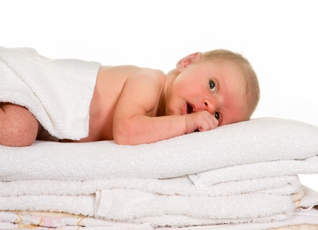 white towels: Newborn baby lying on a stack of laundry towels Stock Photo